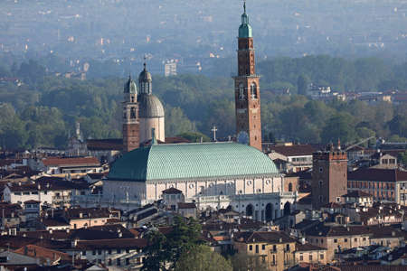 Famous Monument called Basilica Palladiana in Vicenza City in Northern Italy and the big tower called Torre Bissara Editorial