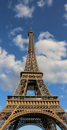 Fantastic Eiffel Tower symbol of Paris in France and the white clouds in blue sky