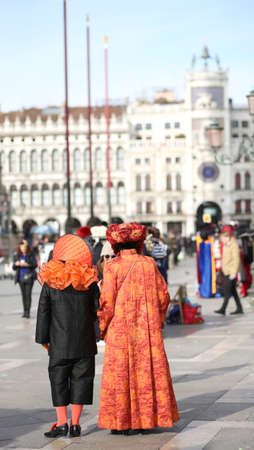 People masked during the Carnival party in Saint Mark Square in Venice in Italy