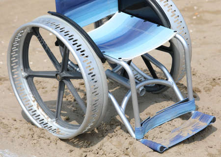 jammed wheelchair on the sand of the beach
