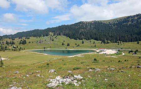 alpine landscape with lake called Lago Coe in Northern Italy