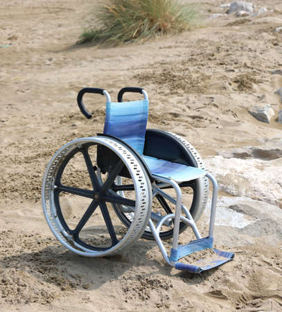 special wheelchair with big wheels on the sand of the beach in summer