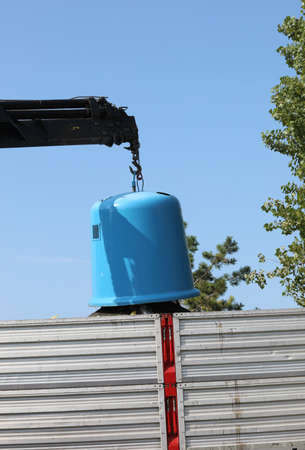 big hanger of the truck and the big blue bell jar to collect waste glass and other materials