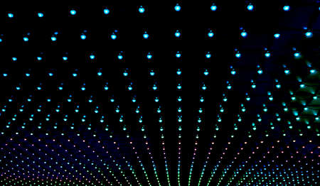 many colored dots on the black background