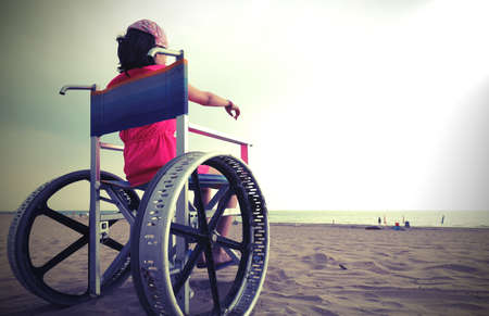 young girl on the wheelchair in summer
