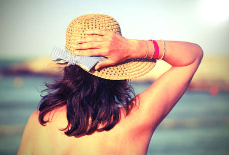 Beauty woman with straw hat in summer and  with old toned effect