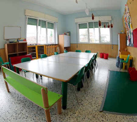 green chairs and tables for nursery school lessons without children Banque d'images