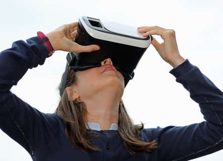 little girl with virtual reality visor on white background 写真素材