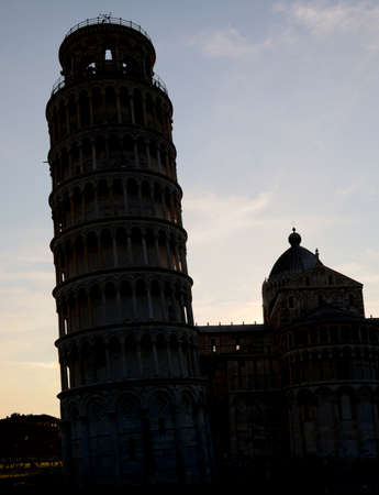 black silhouette of Leaning Tower of Pisa in backlight
