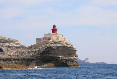 Small ancient red lighthouse near Bonifacio Town in Corsica a french Island in the Mediterranean Sea in Europe