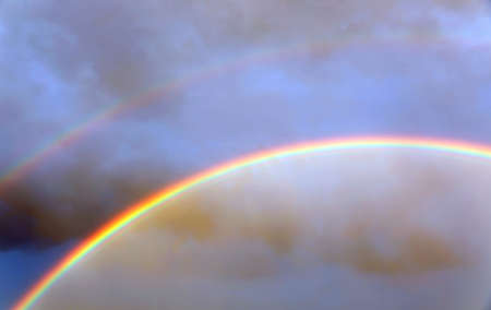 double rainbow after the storm with vivid colors and blue sky