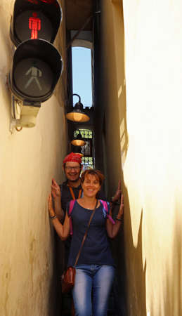 The narrowest street in Europe is in Prague City in Czech Republic with man and woman Reklamní fotografie