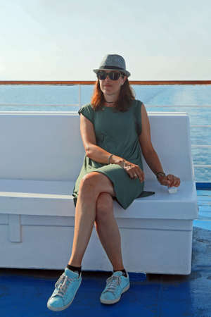Young woman on the cruise liner in summer