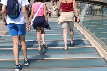family walks on the modern bridge in Venice Italy called Ponte di Calatrava  or Ponte della Costituzione that means Constitution Bridge