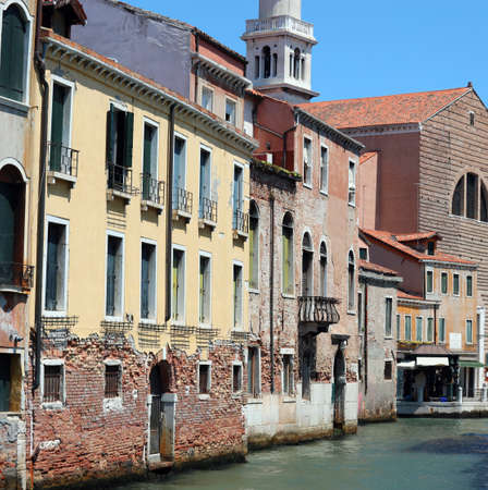 Old house and a church on Venetian Island in Northern Italy