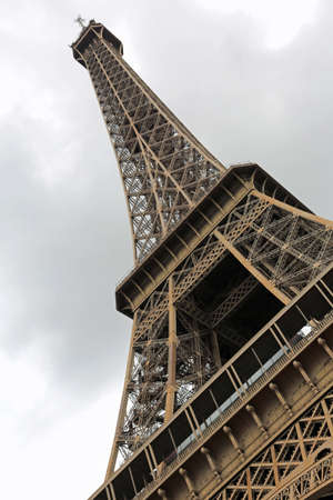 eiffel tower seen from below intentionally inclined in vertical format without people Фото со стока