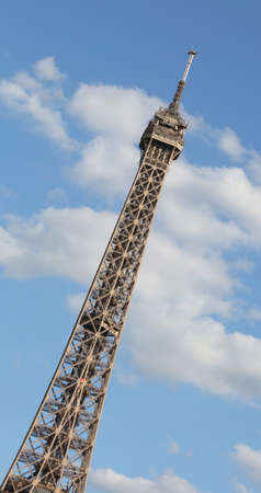 Eiffel Tower in Paris intentionally tilted in vertical format and the blue sky in the background
