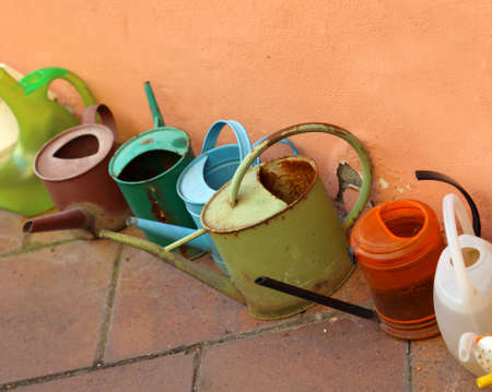 many watering cans in the garden