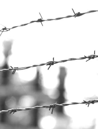 three dramatic lines of wire thrown into a prison camp with black and white tones Фото со стока