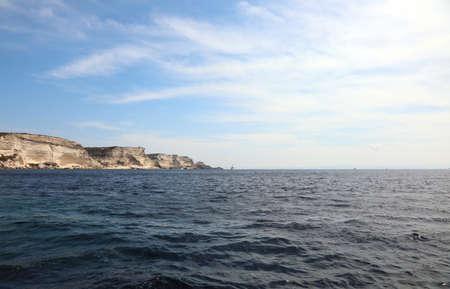 high cliffs of the island of Corsica and the Mediterranean sea near the city of BONIFACIO on a warm sunny summer day