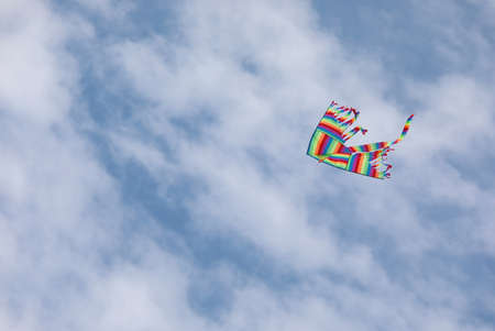 kite flying tall on the blue sky