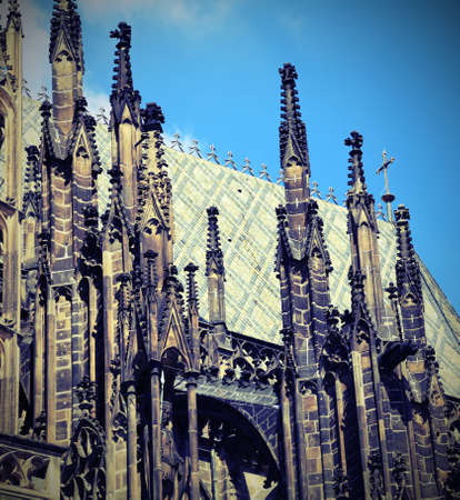 detail of gothic Spires of Saint Vitus Cathedral in Prague in Czech Republic in Central Europe with old toned effect