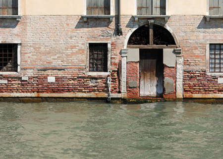 House with old wooden door on the Grand Canal in Venice Italy