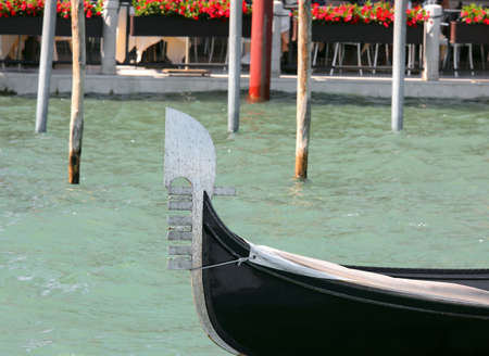 metal bow of a boat called GONDOLA typical nautic vessel in Venice in Italy Stock Photo