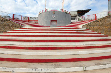 Ajaccio, France - August 28, 2019: Red and White Stairway of Stadium at Corsica Island