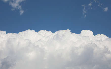 big white soft clouds in summer and blue clear sky