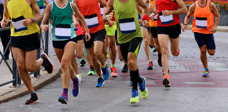 group of athletes runninng on the road during a footrace