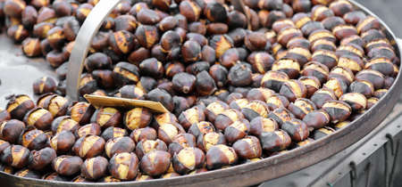 roasted chestnuts for sale at kiosk on the street in autumn