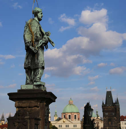 statue of John Nepomucene at Charles Bridge in Prague Czech Republic at the site where the saint was thrown into Vltava River