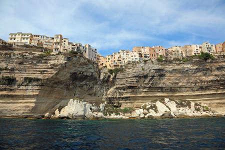 incredible view of the house of Bonifacio in Corsica Island over the cliff and the mediterranean sea Фото со стока
