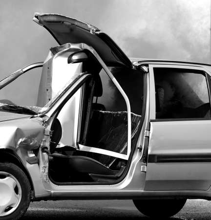 black and white photo of a broken car after an accident