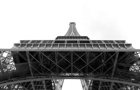 Bottom view of Eiffel Tower with white background and black and white effect
