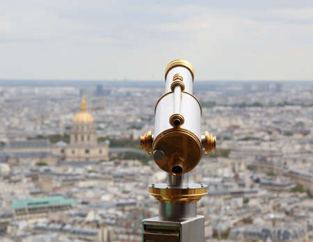 telescope on Eiffel Tower in Paris France and the Golden Dome of monument called Les Invalides