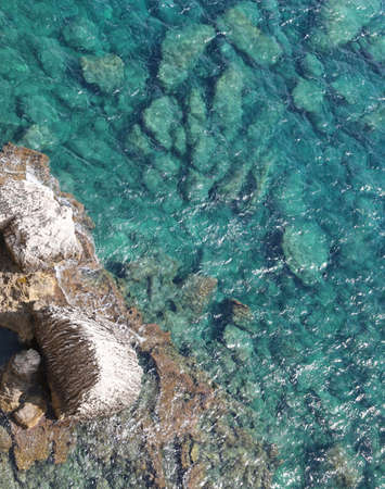 aerial view of sea with clearness water and the rocks