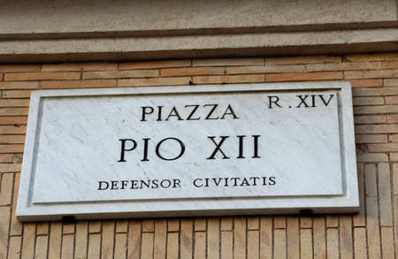 street name Piazza PIO XII in Rome Italy and the text that means Square Pio 12 defender city Banco de Imagens