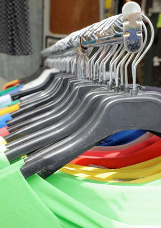 clothes stand and colorful t-shirt from the outdoor street market stall Stok Fotoğraf