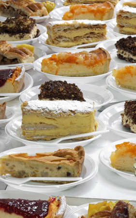 many pieces of cake at restaurant with fruits and custard