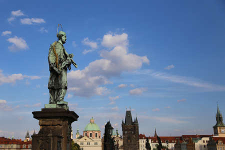 statue of John of Nepomuk at Charles Bridge in Prague Czech Republic at the site where the saint was thrown into Vltava River