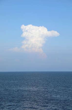 huge vertical white cloud on the ocean