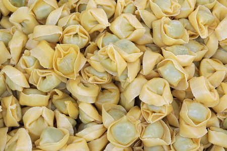 home made tortelli a typical italian dish in spinach and cheese inside