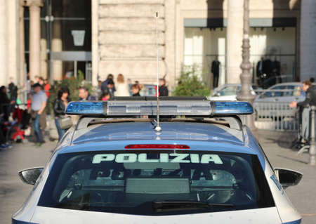 Rome, RM, Italy - March 3, 2019: police car with text Polizia that means POLICE in Italian language in Colonna Square