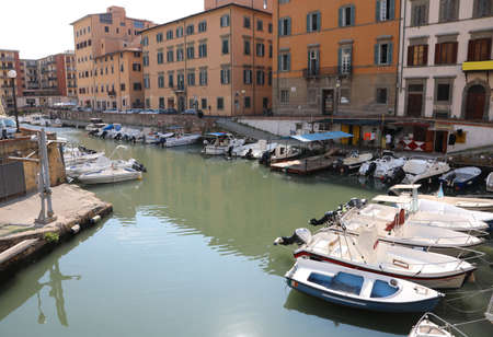 Livorno, LI, Italy - August 22, 2019: small harbor with boats on the city of tuscany