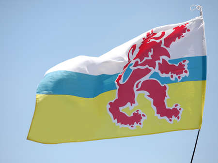 Big flag with red lion of Limburg Province in The Netherlands in Europe