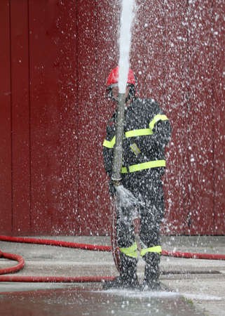 brave firefighter with hydrant and foam to extinguish the fire