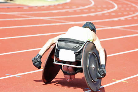 young athlete on wheelchair during a race at sport venue