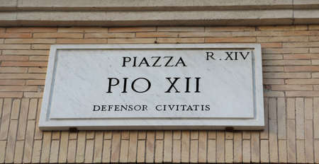 street name Piazza PIO XII in Rome and the text that means Square Pope Pio XII defender city